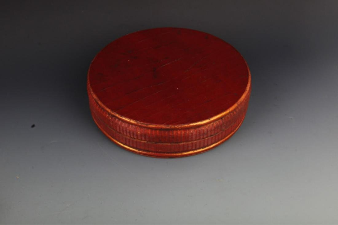 A FINE GILT ROUND WOODEN FOOD CONTAINER - 6
