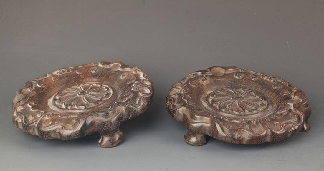 PAIR OF FINELY CARVED BLACK HARDWOOD BASE