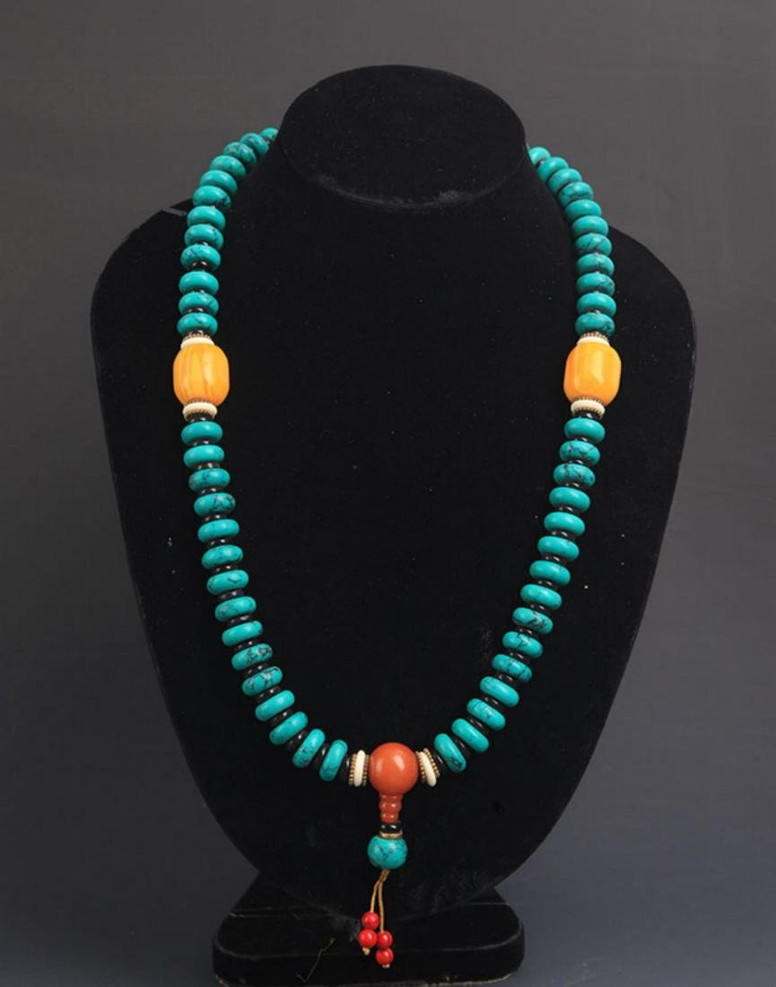 A TURQUOISE WITH BEESWAX NECKLACE