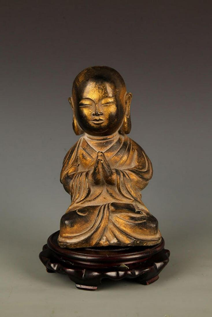 A FINELY CARVED YONG BUDDHA BRONZE FIGURE