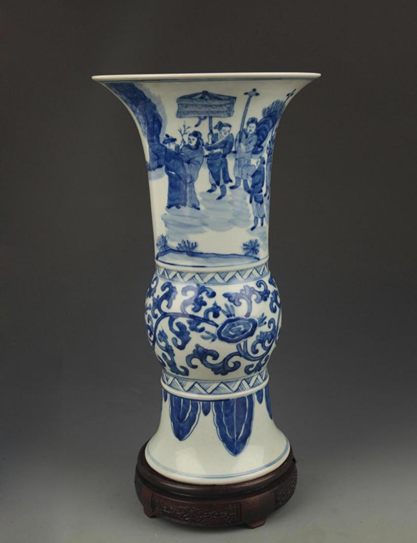 A BLUE AND WHITE STORY PAINT VASE