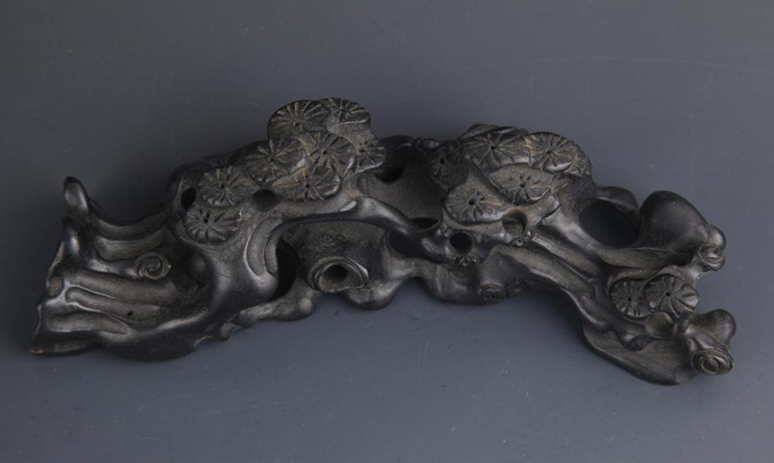 A BLACK HARDWOOD FINELY CARVED BRUSH STAND