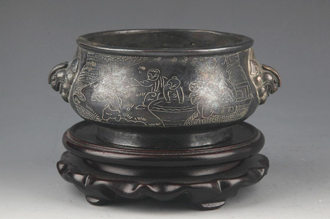 A BRONZE STORY CARVING DOUBLE EAR CENSER