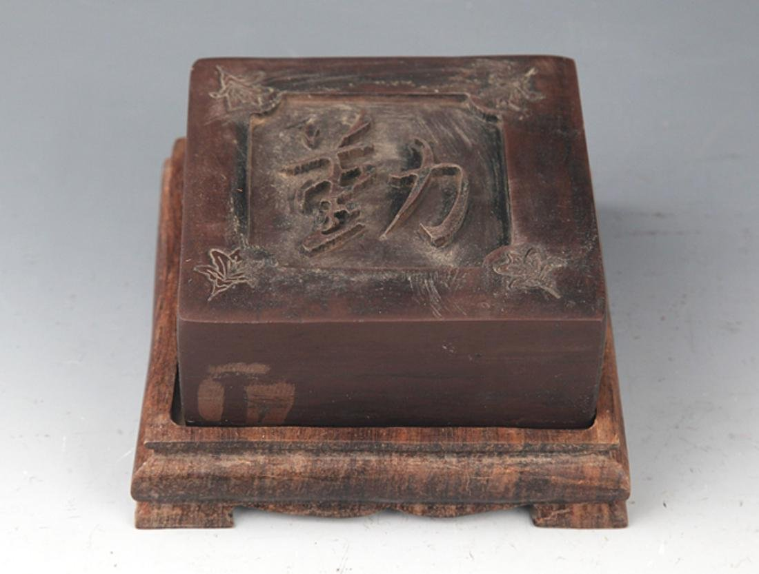 A FINELY CARVED STONE INK WITH BASE