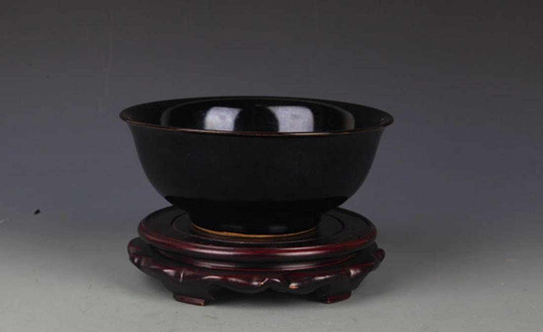 A BLACK COLOR GLAZED PORCELAIN BOWL