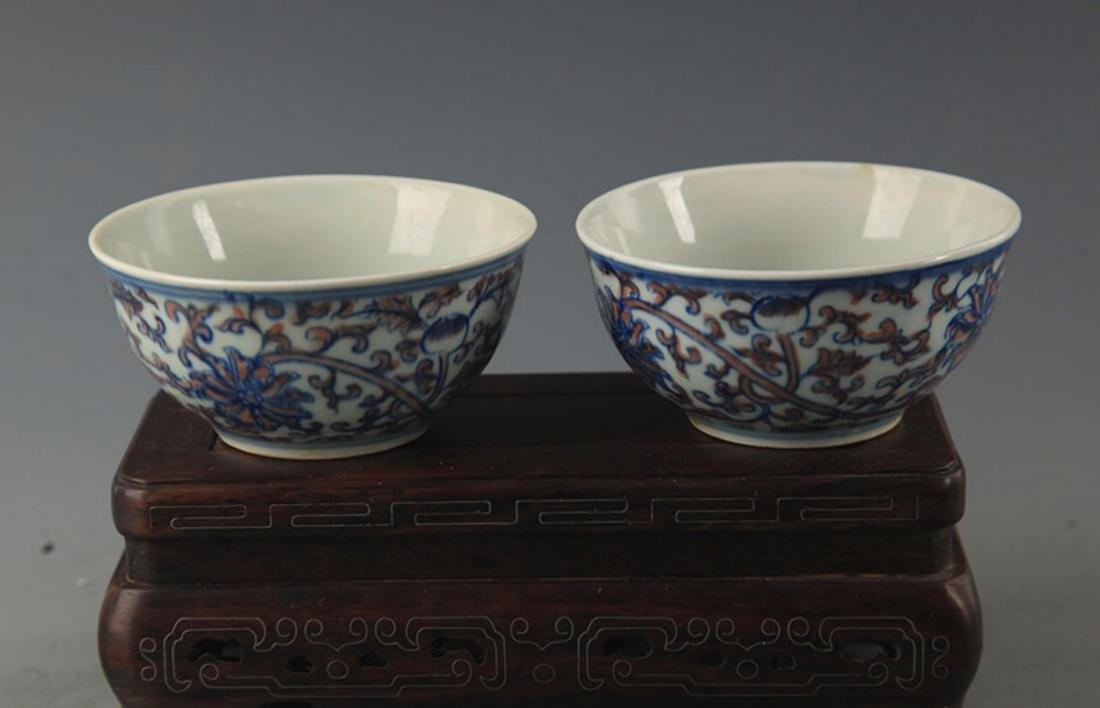 PAIR OF BLUE AND WHITE LOTUS PATTERN PORCELAIN CUP