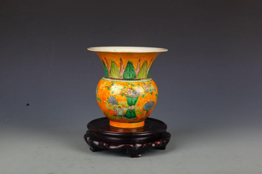 A YELLOW GROUND SAN CAI COLOR SPITTOON