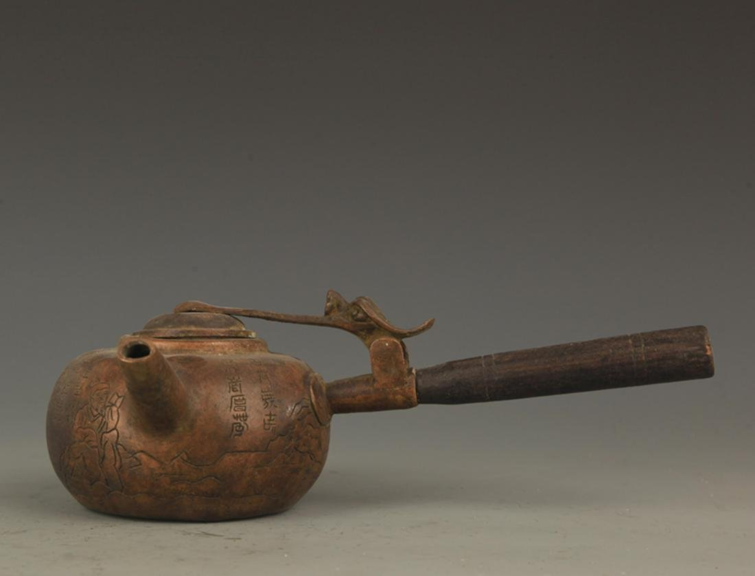 A FINE LONG HANDLE AND CARVED WATER EWER