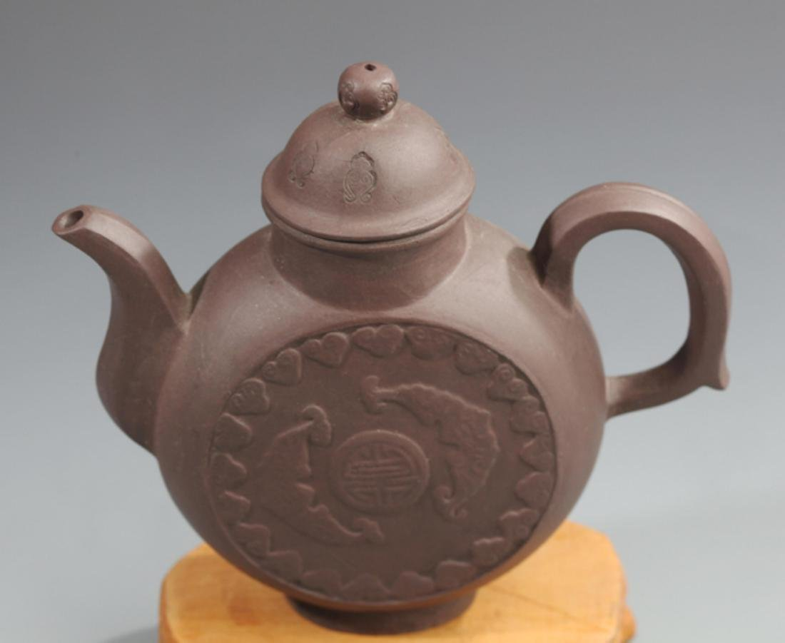 A FINELY MADE ZI SHA TEAPOT WITH HANDLE - 2