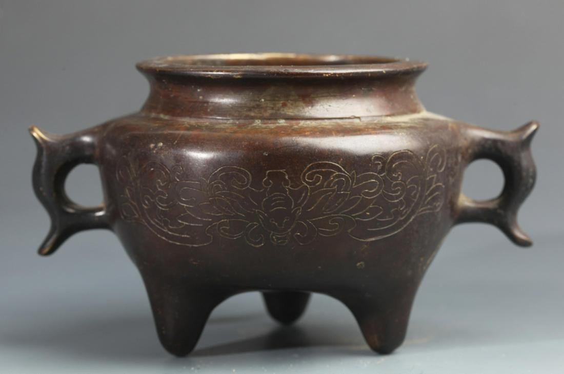 A CARVED TRIPOD BRONZE CENSER WITH TWO HANDLE