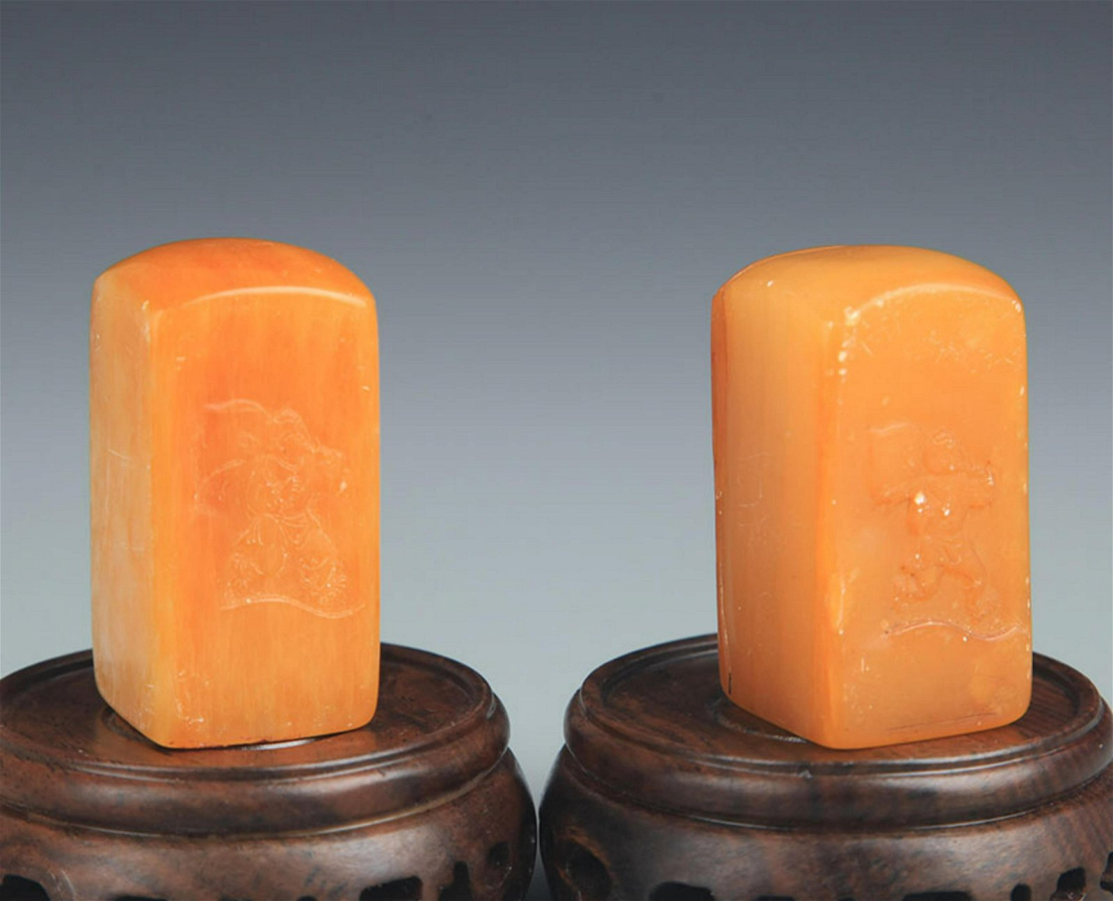 PAIR OF SOAP STONE BOY CARVING SEAL