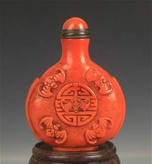 A CHINESE LACQUER MADE FINELY CARVED SNUFF BOTTLE