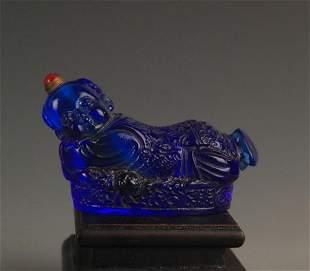 A FINE BLUE GLASS LUCKY BOY SNUFF BOTTLE