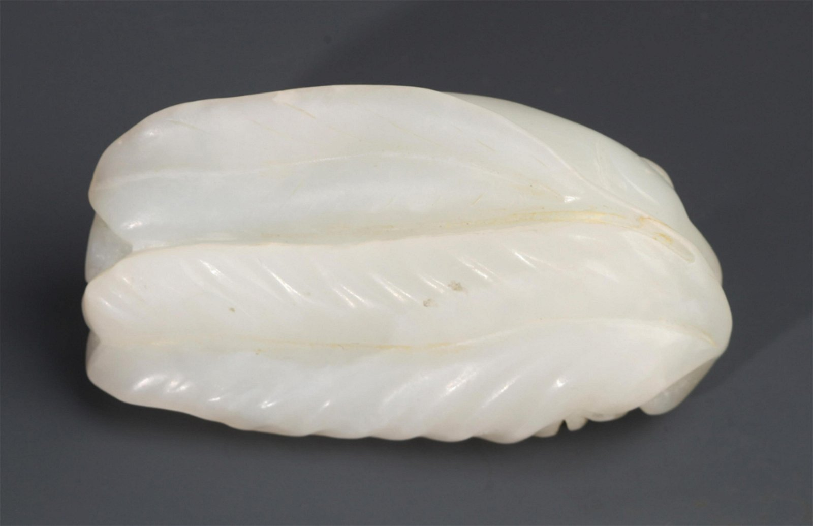 """A FINELY CARVED WHITE JADE DECORATION, CARVED OF """"RUI"""