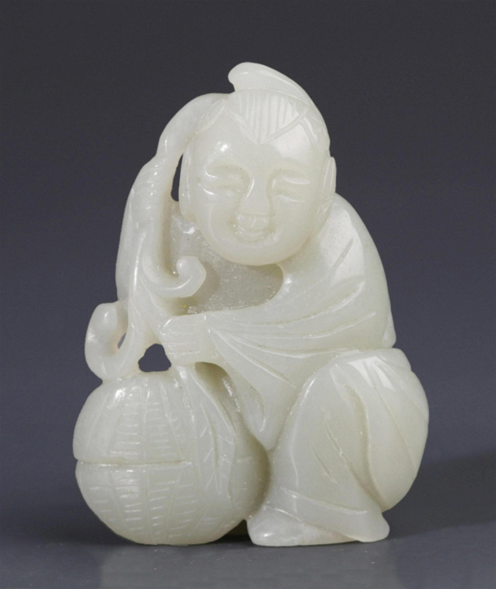 A FINELY CARVED HETIAN GREENISH WHITE JADE