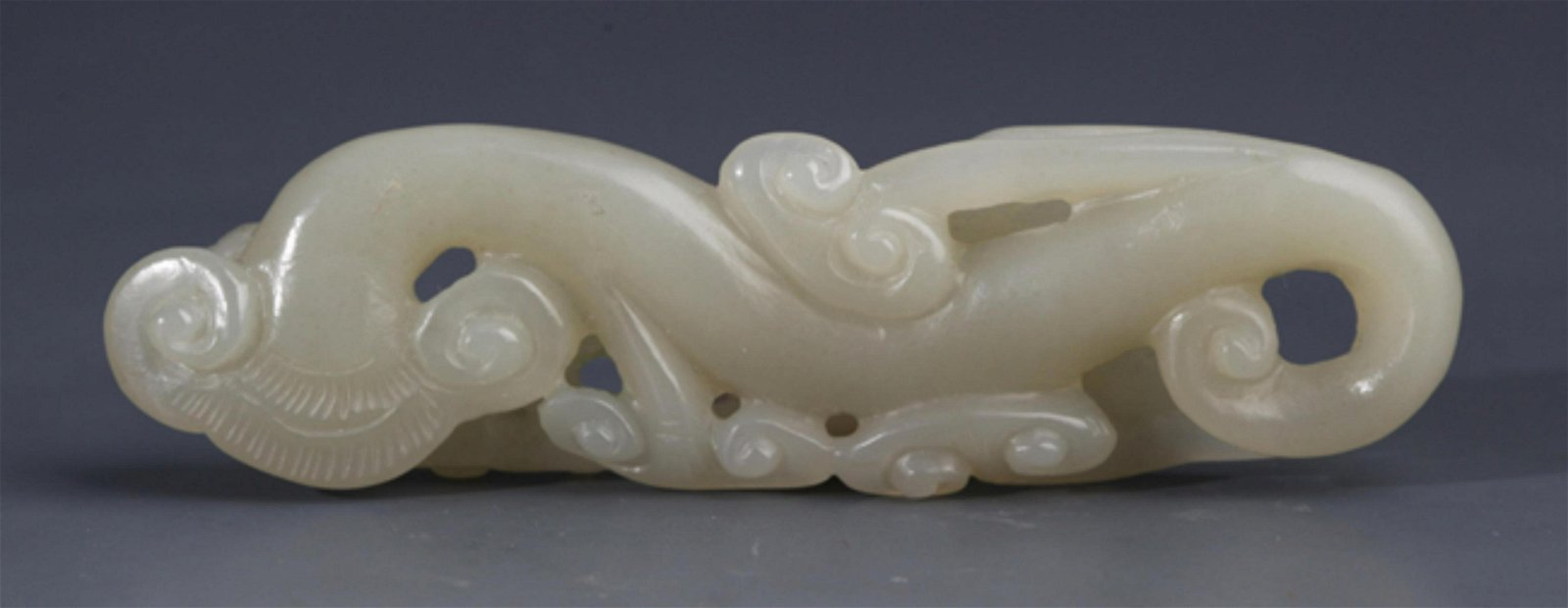 A FINELY HOLLOW CARVED HETIAN GREENISH WHITE JADE