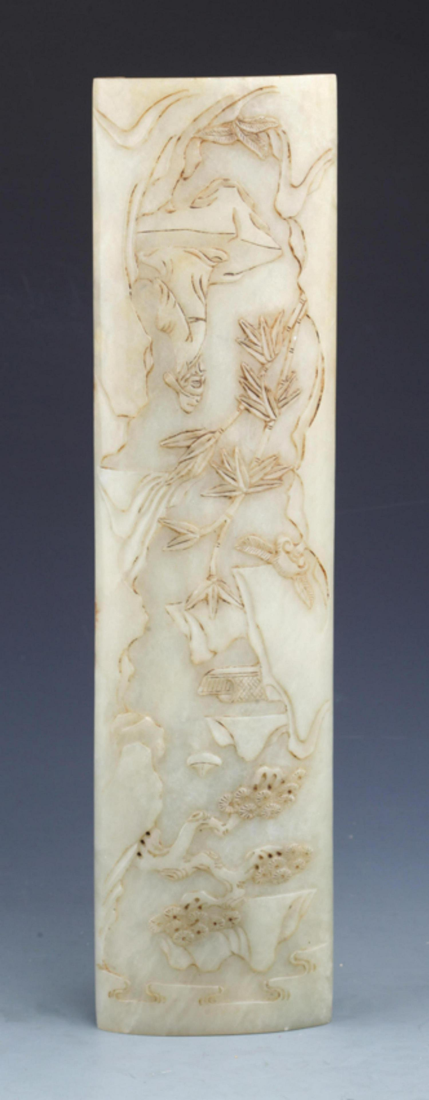 RARE AND FINELY CARVED WHITE JADE ARMREST