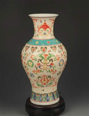 A FAMILLE ROSE FLOWER PAINTED DECORATIONAL VASE