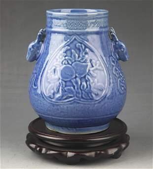 A BLUE GLAZED ELEPHANT EAR PORCELAIN JAR