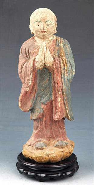 A FINELY PAINTED WOODEN BUDDHA FIGURE