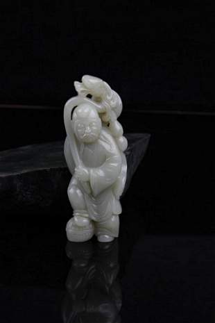 A FINE HE TIAN JADE IN FIGURE OF THE MAD MONK