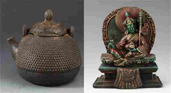 A TIBETAN BUDDHISM FIGURE AND CAST IRON TEA POT