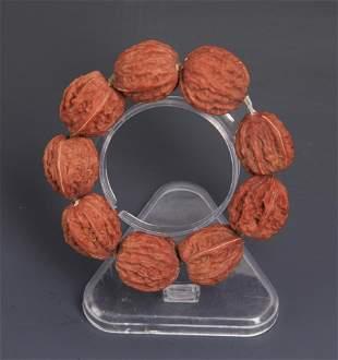A SMALL WALNUT SEED BRACELETS