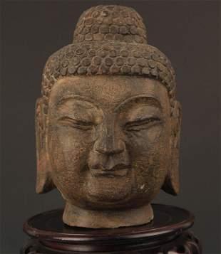 A FINELY CARVED BUDDHA STONE HEAD