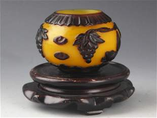 A SMALL CARVED YELLOW COLOR GLASS JAR