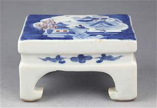 A SMALL BLUE AND WHITE PORCELAIN INK TABLE