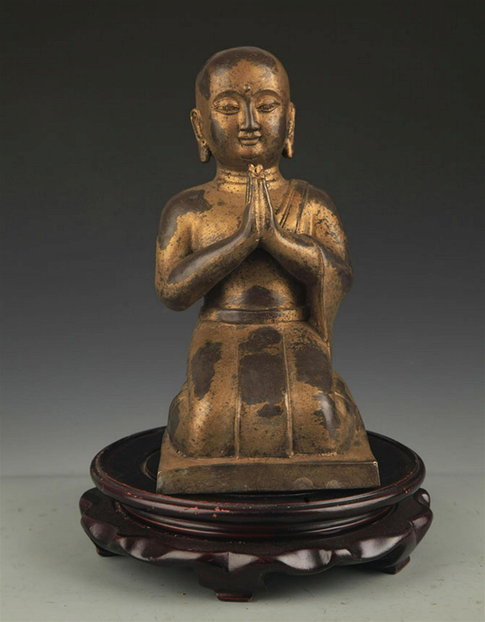 A FINE BRONZE KNEELING BUDDHA