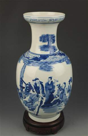 A BLUE AND WHITE STORY PAINTED PLATE TOP VASE