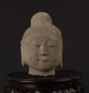 A FINELY CARVED STONE BUDDHA HEAD