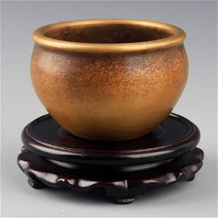 A SMALL AND ROUND BRONZE INCENSE BURNER