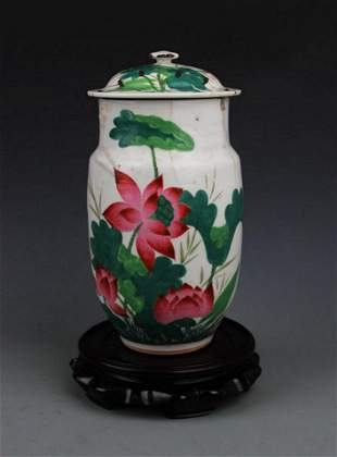 A FAMILLE ROSE LOTUS PAINTED JAR WITH COVER