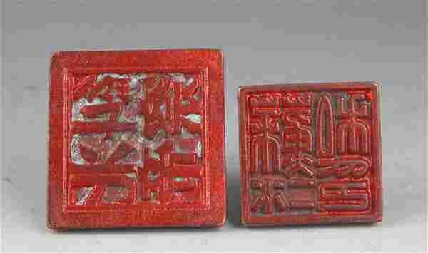 A GROUP OF TWO FINELY CARVED BRONZE SEAL