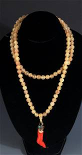 A FINE HORN MADE NECKLACE WITH RED CORAL