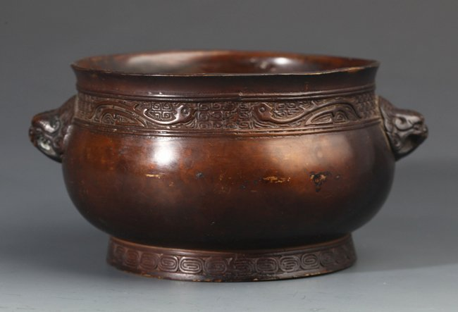A RARE CAVED BRONZE CENSER