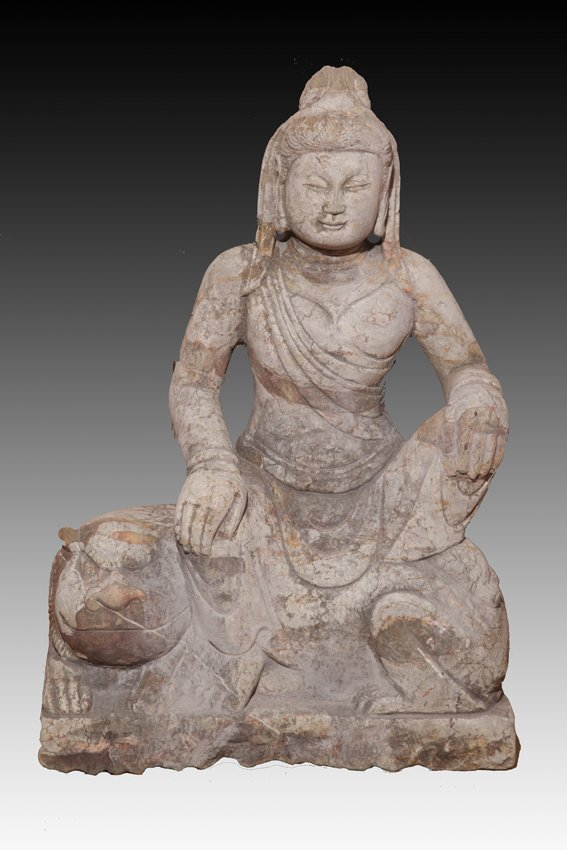 A LARGE GREY STONE BUDDHA FIGURE