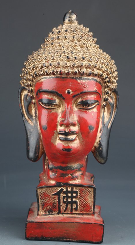 A GILT-LACQUERER WOOD FIGURE BUDDHA HEAD