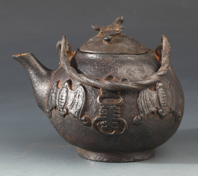 "AN UNUSUAL ""BAT"" CARVED IRON TEA  POT"