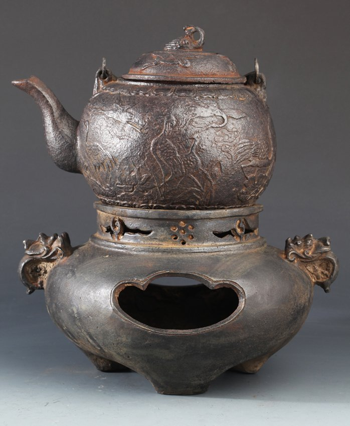 "A SET OF ""CRANE"" CARVING IRON TEA POT"