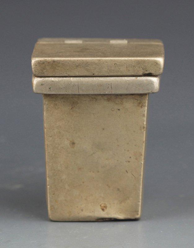 A BRONZE SQUARE TOBACCO BOX WITH COVER