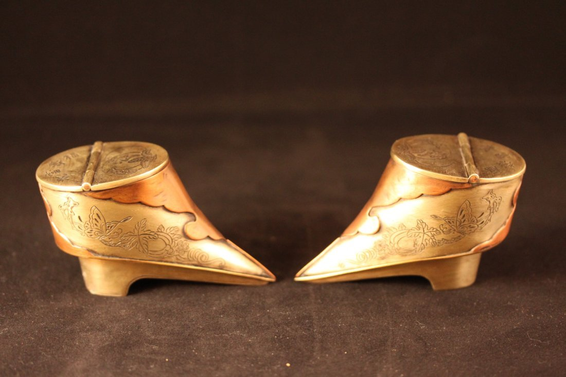 A PAIR OF BRONZE BOXES IN THE SHAPE OF LOTUS FEET