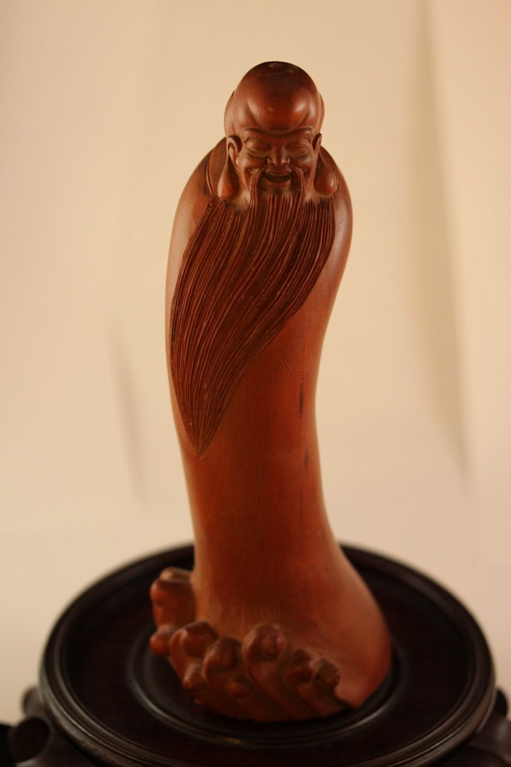 A BOXWOOD CARVED FIGURE