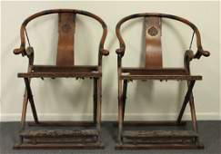 A PAIR OF HUANGHUALI HORSESHOE-BACK FOLDING ARMCHAIRS