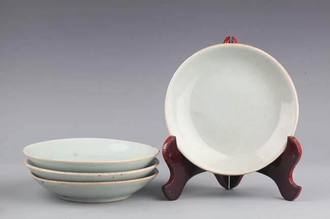 A GROUP OF FOUR LIGHT BLUE PORCELAIN PLATE