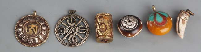 GROUP OF SIX TIBETAN RELIGIOUS PENDANT