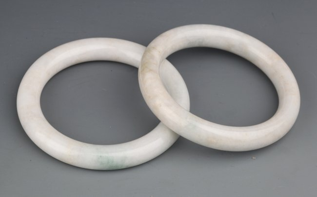 A GROUP OF TWO JADEITE BANGLES