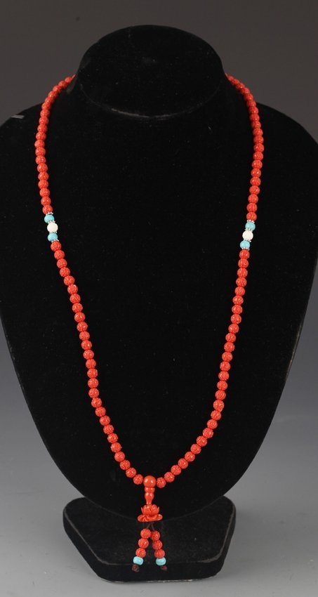 A CARVED CORAL NECKLACE